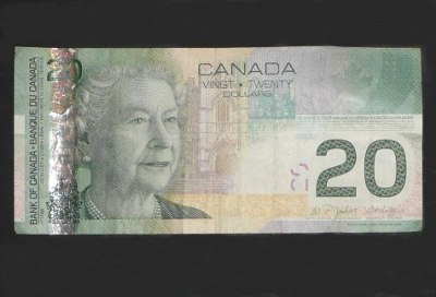 $20 bill hides invisible watermarks and threads